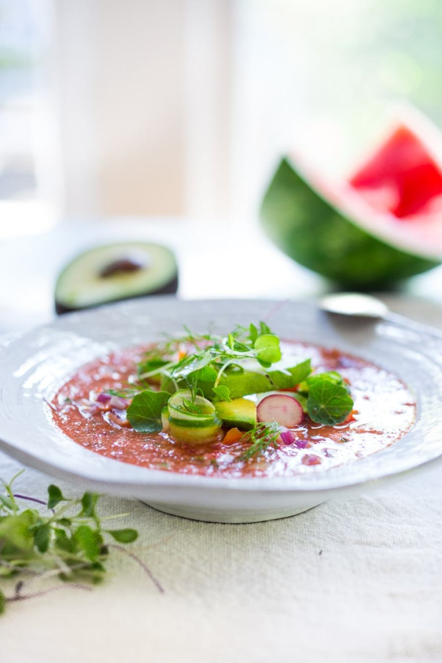 Cool and refreshing Watermelon Gazpacho with avocado, cucumber and sprouts. A easy chilled soup for summer! | www.feastingathome.com