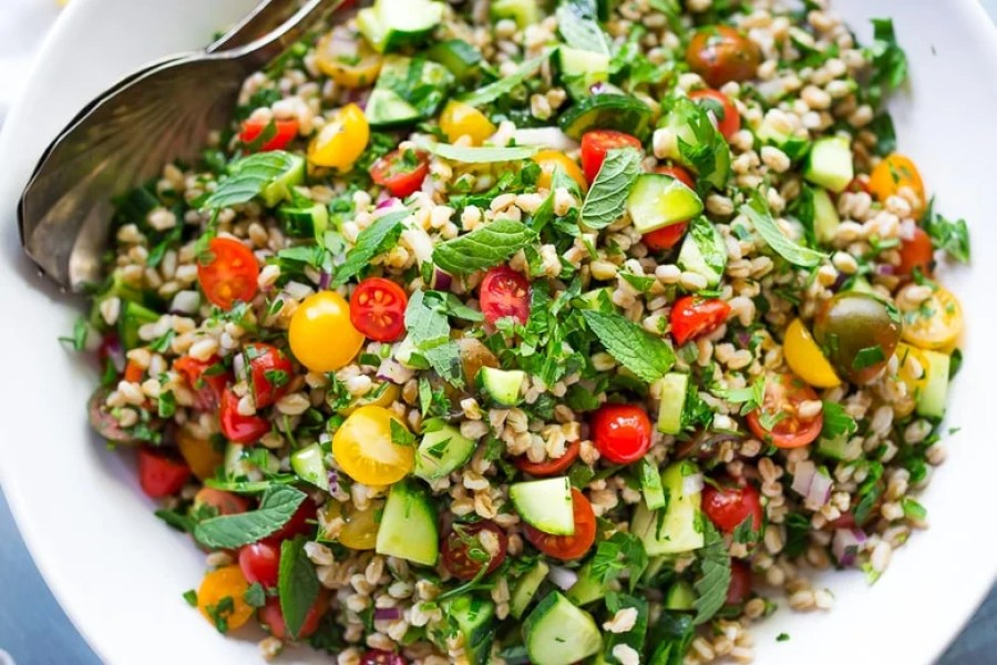 Farro Tabbouleh Salad with tomatoes, cucumber, fresh herbs and a simple lemon dressing. | www.feastingathome.com