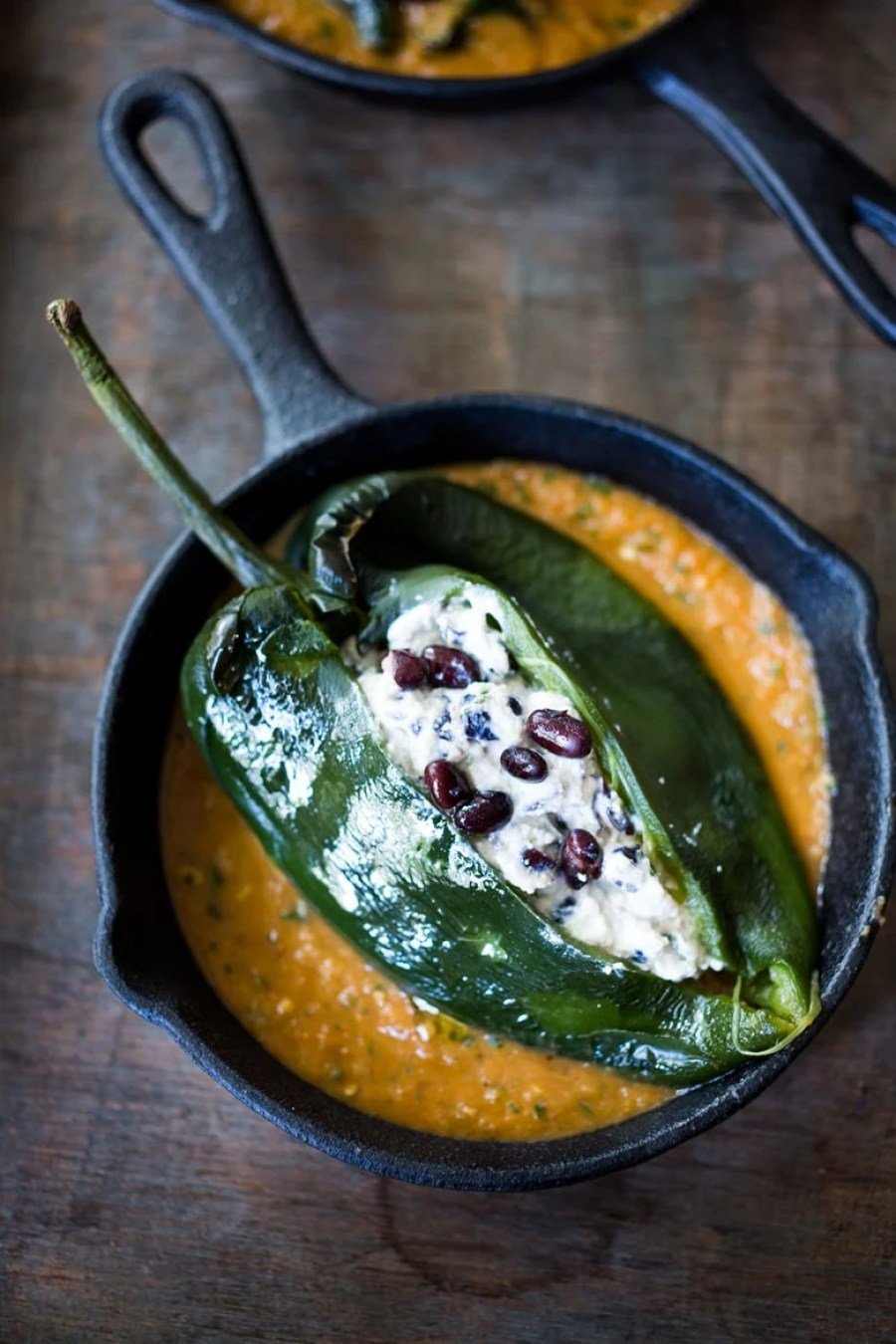 A vegan Roasted Chile Rellenos Recipe -simplified by roasting (not frying) the peppers and Rancheros sauce ingredients all together on one sheet-pan in the oven! | www.feastingathome.com #chilerellenos #vegan #roasted