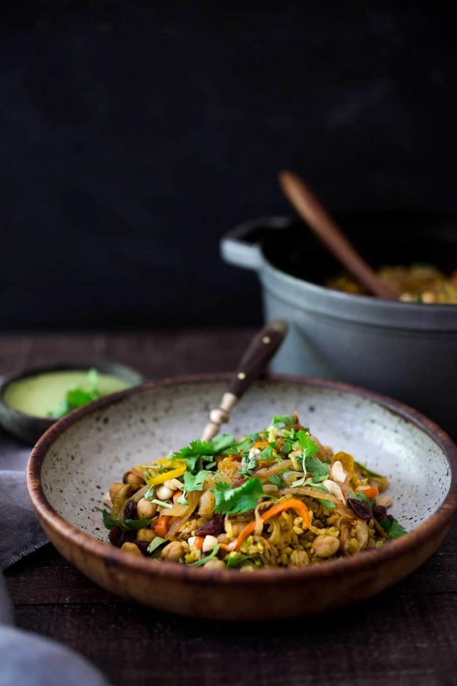 Quick Chickpea Biryani w/ Cilantro Yogurt Sauce. A fragrant rice dish infused went Indian spices - vegan and gluten-free. A quick and easy weeknight meal.   www.feastingathome.com