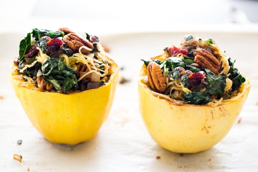 Stuffed Spaghetti Squash with Pecans, Kale and Dried Cranberries, a simple delicious weeknight meal. Vegan & GF | www.feastingathome.com
