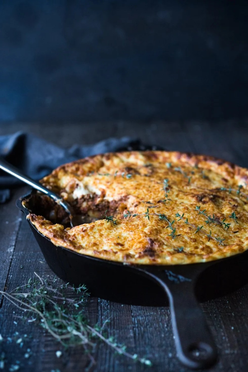 Simple authentic Greek baked pasta dish with a rich flavorful lamb (or beef) bolognese infused with Greek spices and flavors. Perfect for entertaining!