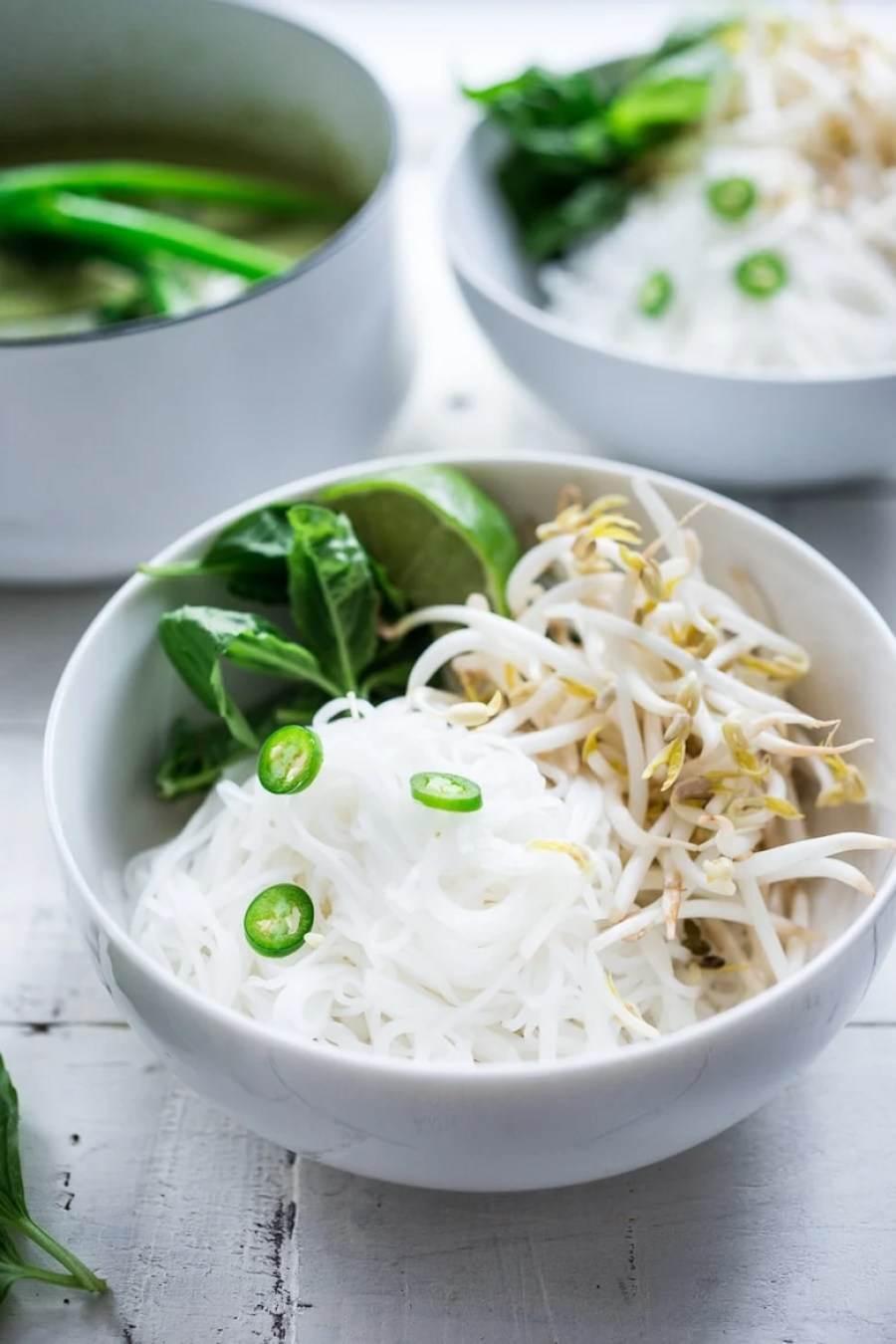 Bone-warming, Thai Green Curry Noodle Soup - with broccolini and and your choice of tofu or chicken.   www.feastingathome.com