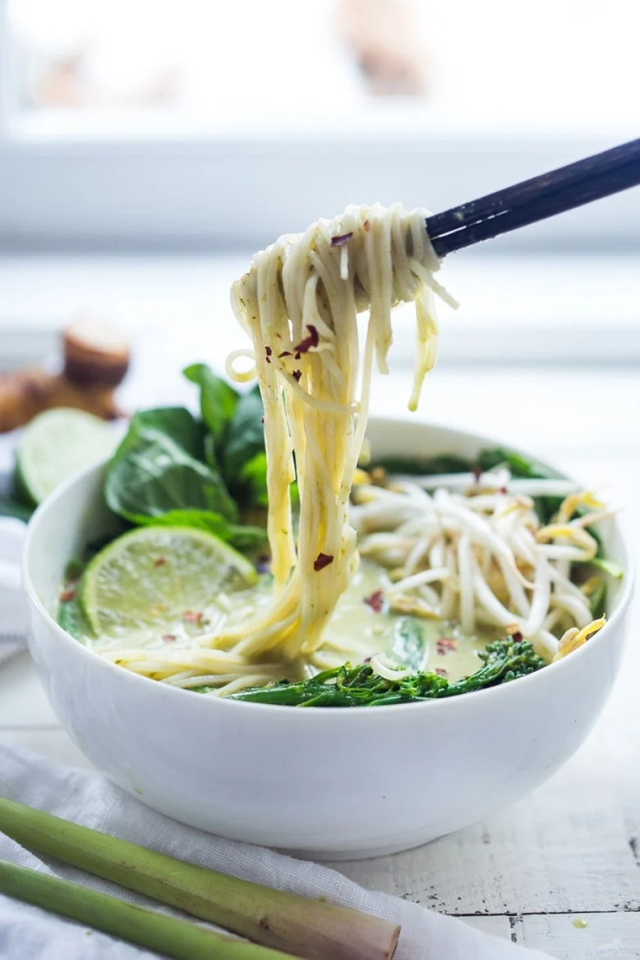 Bone-warming, Thai Green Curry Noodle Soup - with broccolini and your choice of tofu or chicken.   www.feastingathome.com
