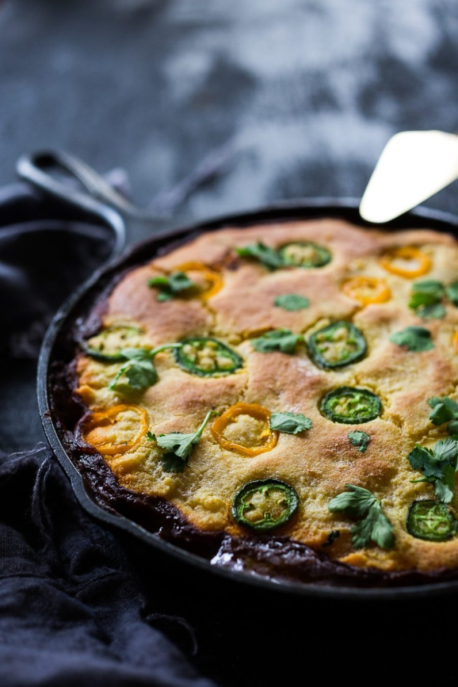 Simple Delicious Tamale Pie with your choice of ground turkey, beef or veggie meat with seasonal veggies, topped with a delicious cornbread crust. | www.feastingathome.com