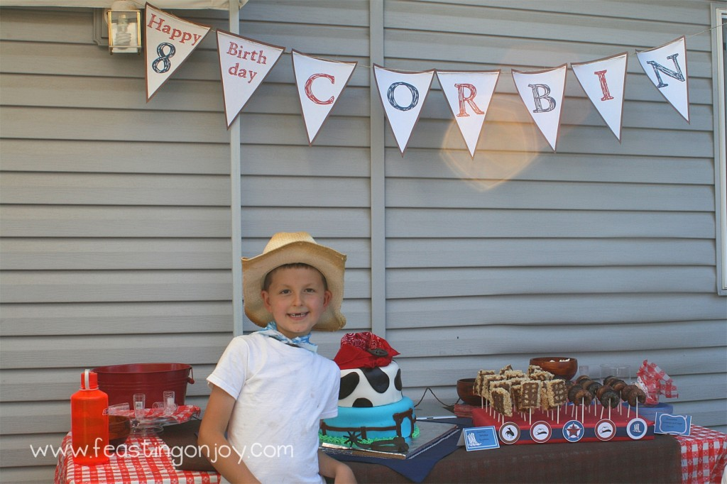 Cowboy Birthday Party birthday boy at dessert table