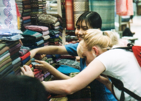In Myanmar, looking at fabric