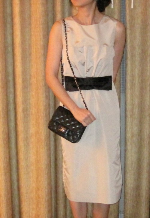 Wearing a Prada dress