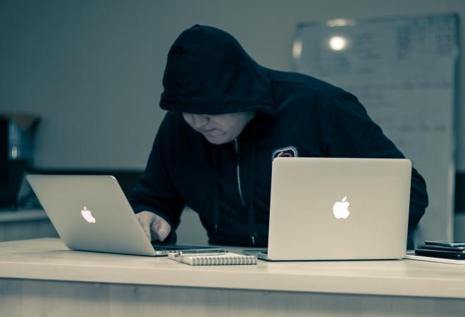 man_black_hoodie_computers