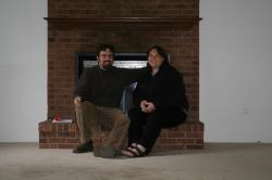 Rob and Clare by the fireplace in the the Zang house
