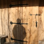 Dave's shadow on Lewis Fender's new shed. Lewis made the hinges himself