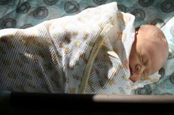 baby burrito sunbathing