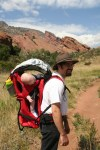 Spencer asleep in the backpack while hiking at Red Rocks