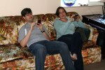 Chris and Sarah playing on their iphones