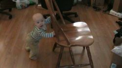 Spencer pushing around a chair