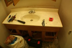 Old vanity with man-made counter top