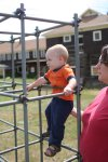 Clare helps Spencer climb the jungle gym at the Elkhorn Lodge