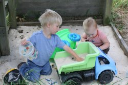Ben and Spencer playing in the sandbox