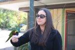 Sarah feeding a lorikeet