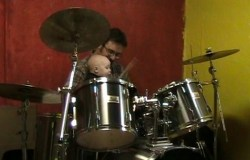 Spencer playing the drums