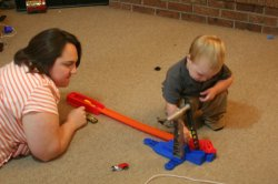 Clare and Spencer playing with hot wheels