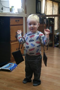 Spencer playing with Clare's purses