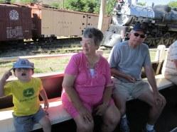 Spencer, Grandma, and Grandpa on the steam locomotive