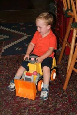 Spencer playing on the digger