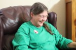Ellen laughing hysterically at her awesome grandpa sweatshirt
