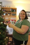 Clare putting ornaments on the tree