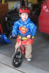 Superman Spencer on his bike