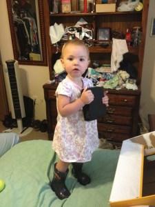Meg wearing a dress and her new Lightning McQueen boots