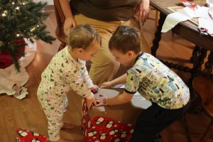 Spencer and Meg opening presents together
