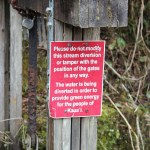 Sign on irrigation ditch