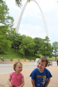 Kids clowning around under the Arch
