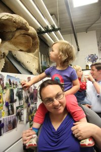 Meg checks out an elephant skull from Clare's shoulders, Charlie amuses Alex