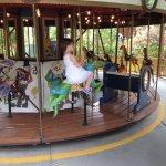 Meg riding the carousel
