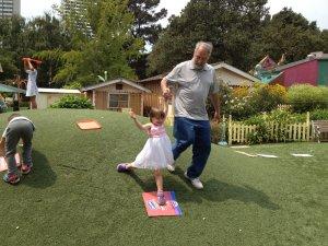 Meg sliding down the hill with grandpa