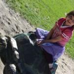Meg on a turtle