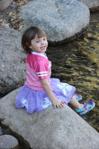 Meg dipping her feet in the river