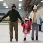 Rob and Ellen help Meg ice skating