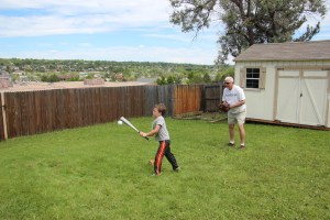 Spencer batting while Grandpa Felty plays catcher