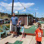 Drew, Grace, Meg, Dave, and Spencer playing putt-putt golf