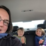 Clare took a selfie of herself and the kids from the car