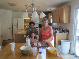 Meg, Sadie, and Grandma Fran making pudding