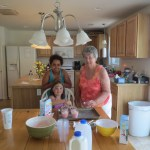 Meg, Sadie, and Grandma Fran making pudding