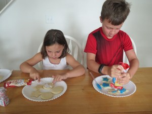 Meg and Spencer frosting cookies