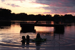 Swimmers at sunset on Horseshoe Lake