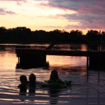 Swimmers at sunset on Horseshoe Lake