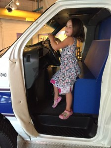Meg driving the ambulance